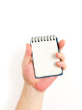 Χέρι και σημειωματάριο Στοκ Εικόνες