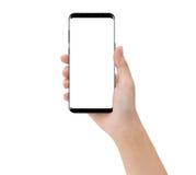 Χέρι κινηματογραφήσεων σε πρώτο πλάνο σχετικά με το τηλέφωνο κινητό που απομονώνει στο λευκό, πρότυπο s στοκ εικόνες