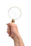 Χέρι με έναν πιό magnifier Στοκ Εικόνες