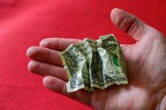 Χέρι με ένα ένα ευρο- νόμισμα σιδήρου και ένα αμερικανικό δολάριο έννοια οικονομική στοκ εικόνες με δικαίωμα ελεύθερης χρήσης