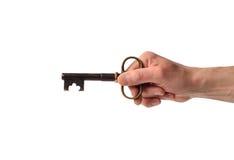 Χέρι με ένα κλειδί Στοκ φωτογραφία με δικαίωμα ελεύθερης χρήσης