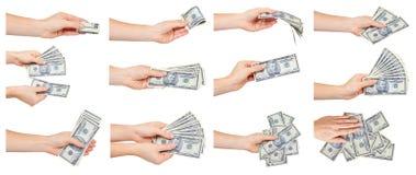 Χέρι με τα αμερικανικά δολάρια εγγράφου, τα αμερικανικά μετρητά, το σύνολο και τη συλλογή στοκ εικόνα