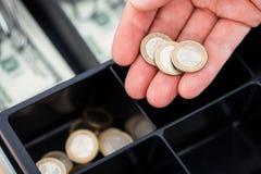 Χέρι με τα ευρο- νομίσματα Στοκ φωτογραφίες με δικαίωμα ελεύθερης χρήσης