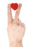Χέρι με την καρδιά πέρα από το λευκό Στοκ Εικόνες