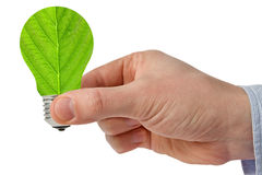Χέρι με την πράσινη ενεργειακή λάμπα φωτός eco Στοκ εικόνες με δικαίωμα ελεύθερης χρήσης