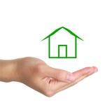 Χέρι με την πράσινη καμπίνα Στοκ εικόνες με δικαίωμα ελεύθερης χρήσης