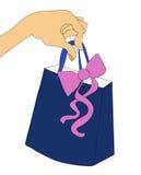 Χέρι με την τσάντα αγορών δώρων Στοκ εικόνες με δικαίωμα ελεύθερης χρήσης