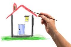 Χέρι με τη βούρτσα που σύρει ένα σπίτι Στοκ φωτογραφία με δικαίωμα ελεύθερης χρήσης