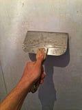 Χέρι με τη μεταλλουργική ξύστρα 02 Στοκ Εικόνα