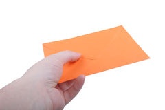 Χέρι με τον πορτοκαλή φάκελο Στοκ Εικόνα