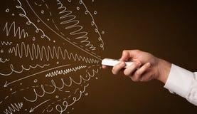 Χέρι με τον τηλεχειρισμό και τις σγουρές γραμμές Στοκ εικόνα με δικαίωμα ελεύθερης χρήσης