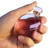 χέρι μπουκαλιών parfume Στοκ φωτογραφία με δικαίωμα ελεύθερης χρήσης