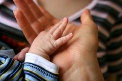 χέρι μωρών Στοκ Φωτογραφίες