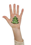 Χέρι παιδιού με το χρωματισμένο σύμβολο Χριστουγέννων διανυσματικά Χριστούγεννα δέντρων απεικόνισης Στοκ φωτογραφία με δικαίωμα ελεύθερης χρήσης