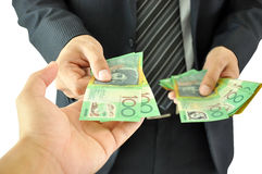 Χέρι που λαμβάνει τα χρήματα - αυστραλιανά δολάρια Στοκ φωτογραφία με δικαίωμα ελεύθερης χρήσης