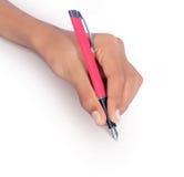 Χέρι που γράφει με τη μάνδρα που απομονώνεται Στοκ Εικόνες