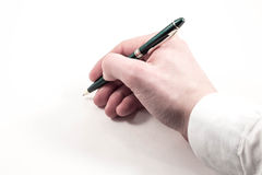 Χέρι που γράφει σε ένα άσπρο υπόβαθρο Στοκ Εικόνα