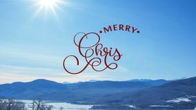 Χέρι που γράφει το άσπρο γράφοντας κείμενο καλλιγραφίας ζωτικότητας Χαρούμενα Χριστούγεννας στο υπόβαθρο χειμερινής snowly φύσης  απόθεμα βίντεο