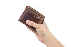 Χέρι που κρατά ένα καφετί πορτοφόλι δέρματος Στοκ Φωτογραφία