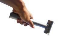 Χέρι που κρατά ένα σφυρί Στοκ Φωτογραφία