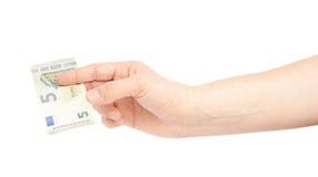 Χέρι που κρατά την ευρο- σημείωση πέντε απομονωμένη Στοκ φωτογραφία με δικαίωμα ελεύθερης χρήσης