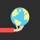 Χέρι που κρατά την μπλε και κίτρινη γη ελεύθερη απεικόνιση δικαιώματος