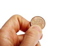 Χέρι που κρατά το ευρο- νόμισμα σεντ πέντε Στοκ φωτογραφία με δικαίωμα ελεύθερης χρήσης
