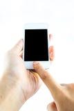 Χέρι που κρατά το κινητό έξυπνο τηλέφωνο Στοκ φωτογραφία με δικαίωμα ελεύθερης χρήσης