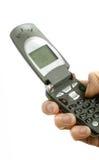 χέρι που κρατά το κινητό τηλέ Στοκ Εικόνες