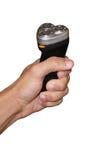Χέρι που κρατά το μαύρο ξυράφι Στοκ Φωτογραφία