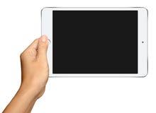 Χέρι που κρατά το μικρό άσπρο υπολογιστή ταμπλετών στο λευκό Στοκ Εικόνες