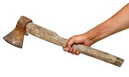 Χέρι που κρατά το μικρό παλαιό σκουριασμένο τσεκούρι απομονωμένο επάνω Στοκ φωτογραφία με δικαίωμα ελεύθερης χρήσης