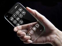 Χέρι που κρατά το φουτουριστικό διαφανές smartphone Στοκ Φωτογραφία