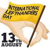 Χέρι που πιάνει μια σημαία για να γιορτάσει τη διεθνή ημέρα αριστερός-Handers, διανυσματική απεικόνιση διανυσματική απεικόνιση
