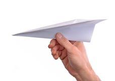 Χέρι που ρίχνει το αεροπλάνο εγγράφου Στοκ Φωτογραφία