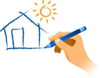 Χέρι που σύρει ένα σπίτι με τον ήλιο Στοκ Φωτογραφίες