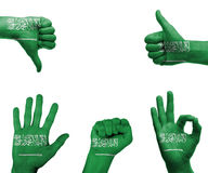 Χέρι που τίθεται με τη σημαία της Σαουδικής Αραβίας Στοκ εικόνα με δικαίωμα ελεύθερης χρήσης
