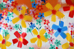 Χέρι που χρωματίζει το αφηρημένο λουλούδι στον τοίχο Στοκ Φωτογραφία