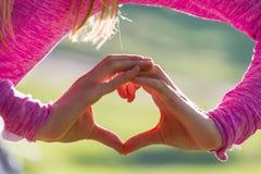 Χέρι στην καρδιά Στοκ Εικόνες