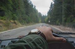 Χέρι στο τιμόνι Στοκ Εικόνες