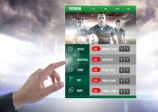 Χέρι σχετικά με ένα στάδιο ράγκμπι διεπαφών στοιχημάτισης App Στοκ εικόνα με δικαίωμα ελεύθερης χρήσης
