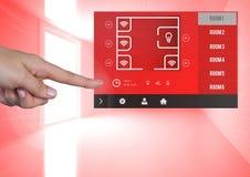 Χέρι σχετικά με μια App συστημάτων εγχώριας αυτοματοποίησης διεπαφή Στοκ Εικόνες