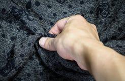 Χέρι σχετικά με το ύφασμα Στοκ Εικόνες