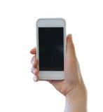 Χέρι της γυναίκας που κρατά ένα smartphone απομονωμένο στο άσπρο υπόβαθρο στοκ φωτογραφία με δικαίωμα ελεύθερης χρήσης