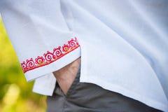 Χέρι του λαϊκού πουκάμισου Στοκ φωτογραφία με δικαίωμα ελεύθερης χρήσης