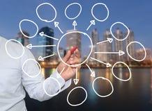 χέρι του επιχειρηματία και του κόκκινου σημείου μανδρών στις κενές γεωμετρικές μορφές Στοκ Εικόνες