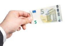 Χέρι του επιχειρησιακού ατόμου με πέντε ευρώ στα τραπεζογραμμάτια Στοκ εικόνα με δικαίωμα ελεύθερης χρήσης