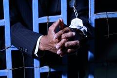 Χέρι του επιχειρησιακού ατόμου στη φυλακή Στοκ Εικόνα
