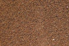 Χαλίκια θάλασσας Μικρό υπόβαθρο σύστασης αμμοχάλικου πετρών Πέτρες αμμοχάλικου Καφετί μικρό σχέδιο χαλικιών Στοκ εικόνα με δικαίωμα ελεύθερης χρήσης