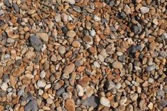 Χαλίκια σε μια παραλία - υπόβαθρο Στοκ Φωτογραφία